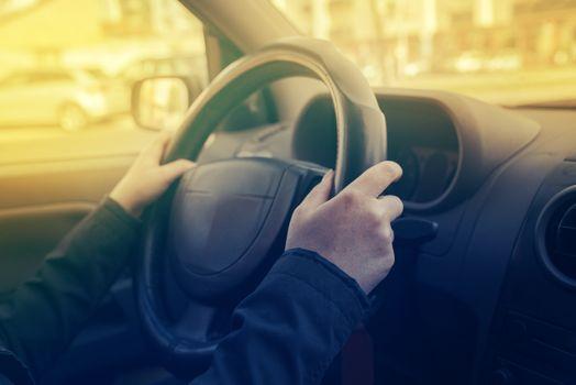 Female hands gripping steering wheel