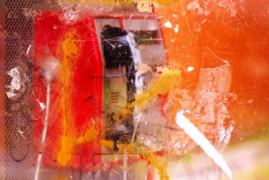 Demolished and vandalized public phone booth on street