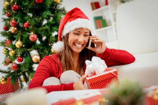 Girl With Santa's Hat And Smart Phone