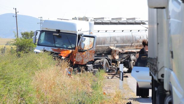 Horizontal image of a tank transporter truck vehicle wreck.