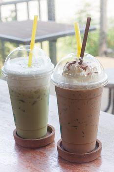 Iced coffee with iced green tea in coffee shop, stock photo