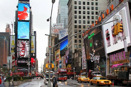 New York, NY, USA - October 09, 2012: Times Square, featured with Broadway Theaters and huge number of LED signs, is a symbol of New York City and the United States, October 09, 2012 in Manhattan, New York City