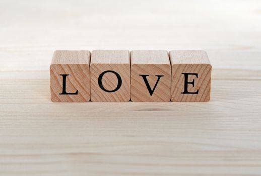 The word Love on wood, background, card