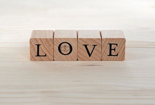 The word Love and two hearts on wood, background, card