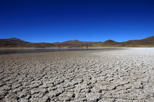 Colorful mountains and dry lake in peruvian andes