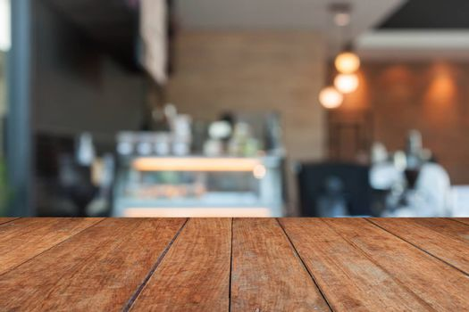 Perspective brown wood with blurred coffee shop, stock photo