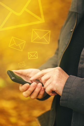 Sending SMS messages on mobile phone in autumn