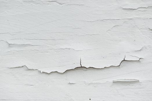 Cracked white paint on plank surface