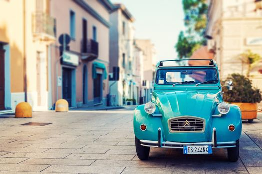 OLBIA, ITALY - JULY 10, 2016: Vintage Citroen 2cv6 standing on the street in Olbia, Sardinia, Italy. Toned photograph in a retro nostalgic style.