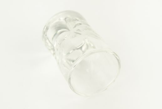 Clean and clear lying empty glass. On a white background.