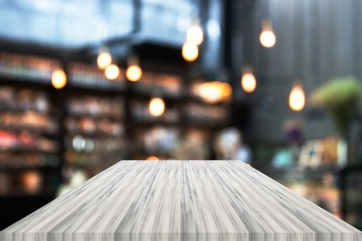 Perspective white luxury wooden with blurred cafe background. product display template