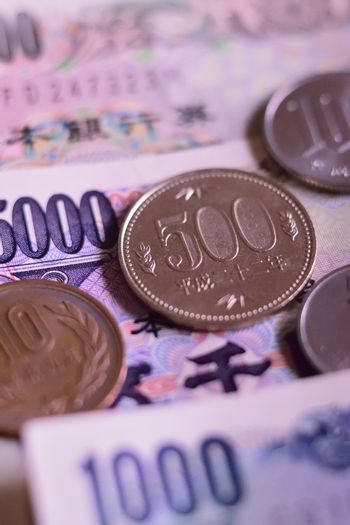 Background of Japanese Yen Currency & Coin in vertical frame