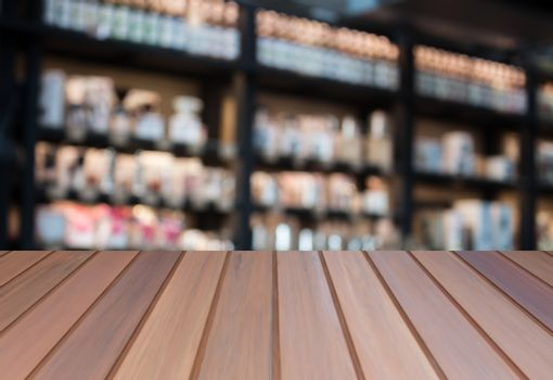 Luxury top wooden with blurred coffee shop background. product display template