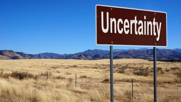 Uncertainty brown road sign