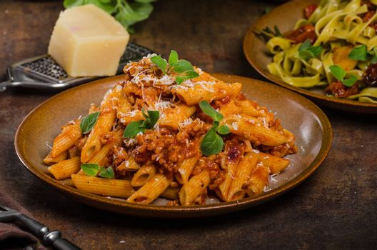 Pasta arrabiata delicious, spicy and simple delicous pasta with meat and parmesan cheese