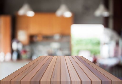 Abstract blur coffee shop with empty wooden top. For product display