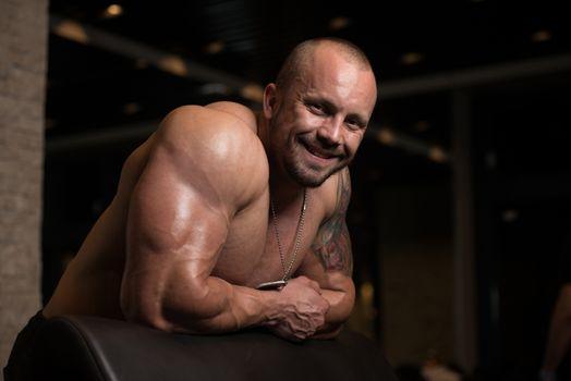 Bodybuilder Resting In The Gym