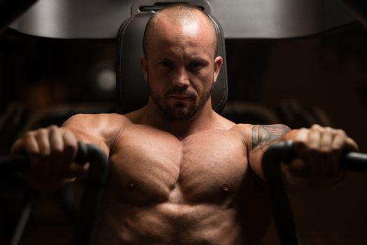 Man Is Working On His Chest With Machine