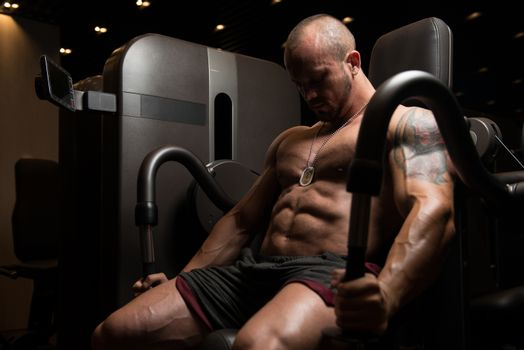 Bodybuilder Doing Exercise For Triceps On Machine