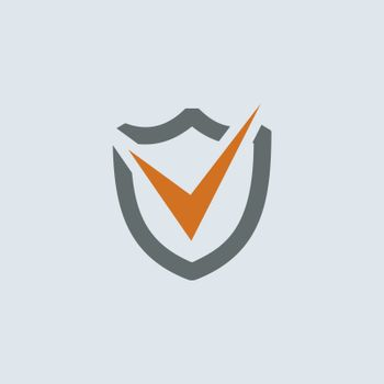 Gray-orange check mark on the shield round web icon