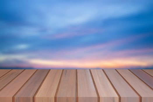 Empty top of wooden table with sunset background. For product display