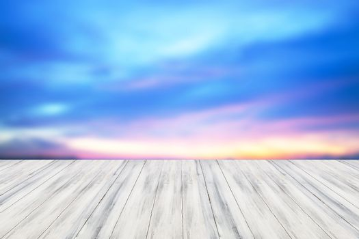 Empty white table top wooden with sunset background. For product display
