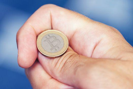 Businessman hand tossing bitcoin