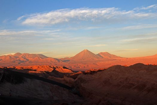 Valle de la Luna, valley of the moon, Volcan Lincancabur in the background, Atacama desert Chile