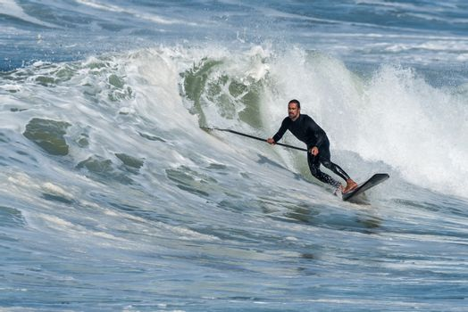 Stand up paddle surfer