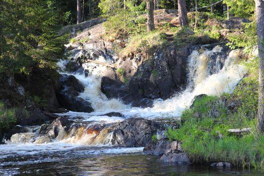 Waterfall in the Republic of Karelia, Russia. Northern nature