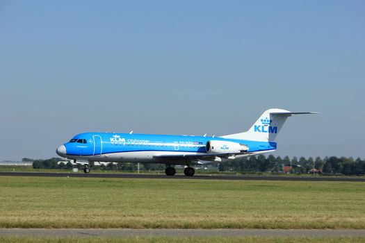 Amsterdam, the Netherlands  - August, 18th 2016: PH-KZS KLM Cityhopper Fokker F70, taking off from Polderbaan Runway Amsterdam Airport Schiphol
