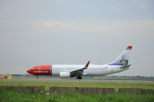 Amsterdam, The Netherlands - August 9 2015: LN-NGP Norwegian Air Shuttle Boeing 737-800  taxing to the Polderbaan runway