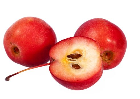Red paradise apples isolated on white background