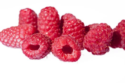 Group of red raspberries isolated on white background