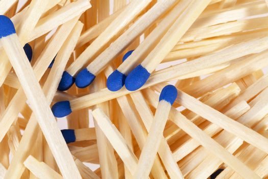 Heap of matches with blue heads isolated on white background
