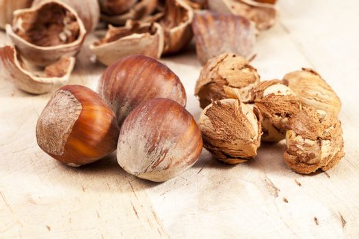 Composition of hazelnuts on wooden plank