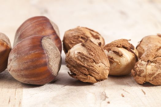 Composition of hazelnuts  wooden plank, close up