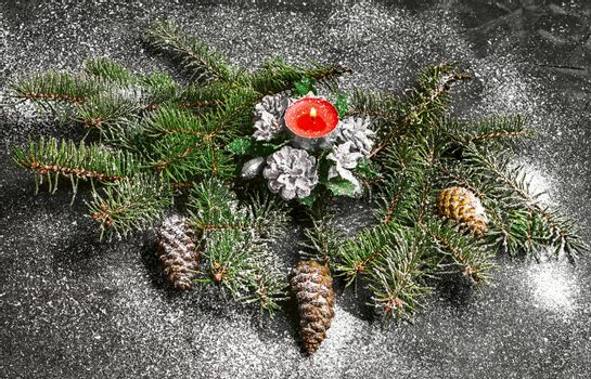 Spruce branches with pinecones and Christmas ornaments