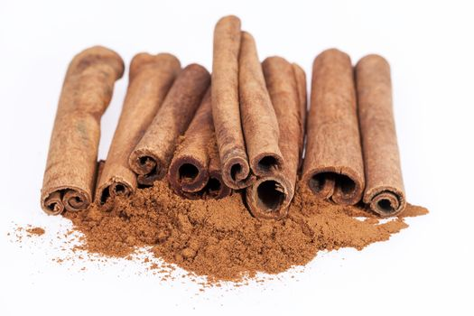 Cinnamon sticks and powder isolated on white background