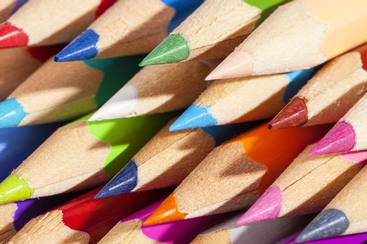 Background of chipped colored crayons, close up