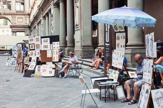 FLORENCE, ITALY - JULY 13, 2016: Painters working and selling artwork in Florence near Uffizi gallery, Italy