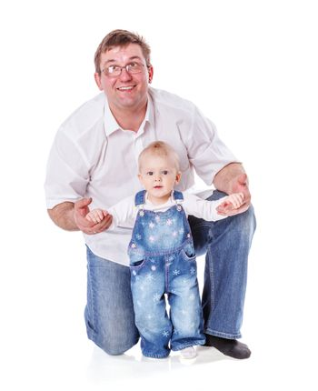 Father with baby girl posing isolated on white