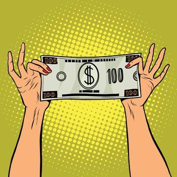 Female hands holding a hundred dollar bill
