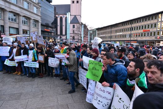 GERMANY, Cologne: Dozens of refugees from Syria, Afghanistan and other  countries demonstrate peacefully against violence and sexism near the Cologne main train station in Cologne, western Germany on January 16, 2016, where hundreds of women were groped and robbed in a throng of mostly Arab and North African men during New Year's festivities. German authorities said that nearly all the suspects in a rash of New Year's Eve violence against women in Cologne were of foreign origin, as foreigners came under attack amid surging tensions.