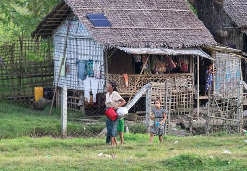 Sittwe - October 25, 2016: Traditional housing with straw roof at the outskirts of Sittwe, the capital of the Rakhine State in Myanmar, a state with little development but with endless ethnic and religious conflicts.