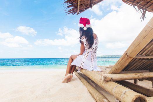 Woman celebrate Christmas on beach