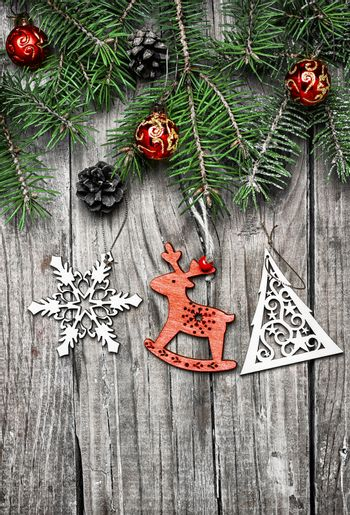 Spruce branches with pinecones and Christmas toy