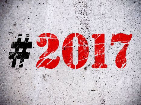 New Year 2017 hashtag rubber stamp on grunge concrete wall illustration