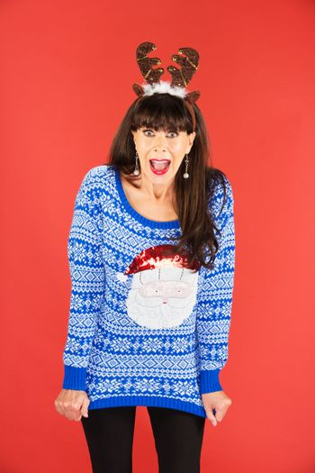 Excited woman in antlers tiara and sweater