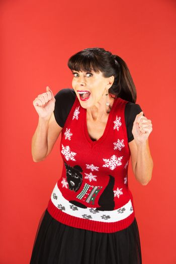 Excited adult female in ugly Christmas sweater